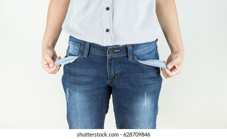 Woman showing empty pockets without money, financial problem concept.