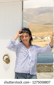 Woman showing the Greek beauty of Andros island.