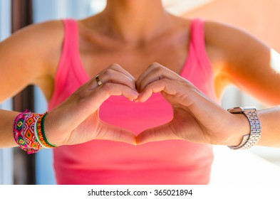 Woman showing the heart sign with her hands