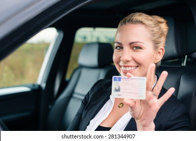 Woman showing her driving license out of car window