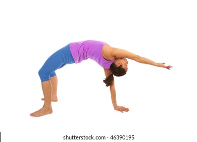 A woman showing her flexibility by doing a yoga move to stretch her body.