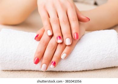 Woman showing her gel manicure