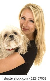 a woman showing her love for her Maltese puppy.