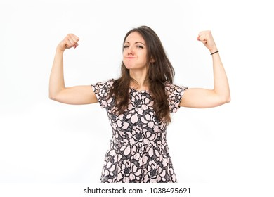 woman showing her muscles on white background, funny girl female power and success concept