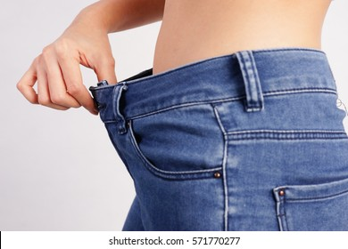 Woman Showing Loose Jeans, Loss Weight