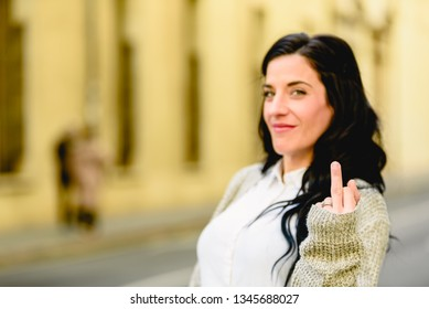 Woman showing middle finger as obscene and offensive insult.