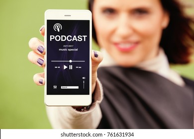 Woman showing mobile phone with podcast app in the screen.