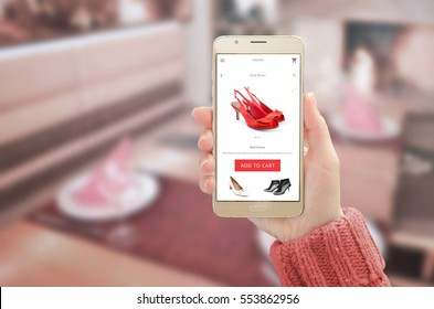 Woman showing modern gold smart phone with online shopping app on device display. Woman red shoes and add to cart button.