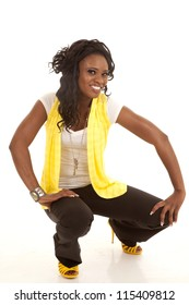 a woman showing off her fashion wearing yellow with a smile on her face.