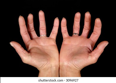 Woman showing open hands. On black clean background.