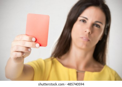 Woman showing a red card. Concept of relationship problems.