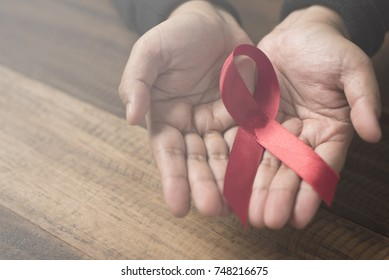woman showing red ribbon ( AIDS ribbon ).Aids / HIV Concept. healthcare and medical concept