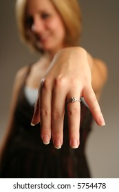 Woman showing ring.