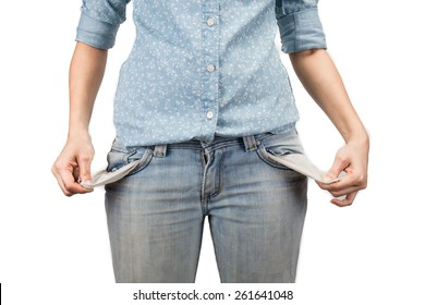 woman showing she has no money by turning out her pockets