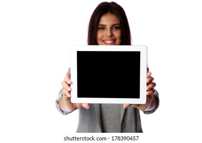 Woman showing smartphone screen on gray background
