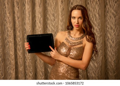 Woman showing tablet screen