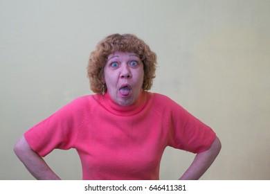 Woman showing tongue