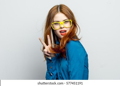Woman showing two fingers. victory sign, peace sign greeting