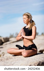 Woman showing a yoga position