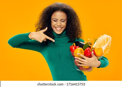 Woman shows a finger at fresh vegetables in the sleeve