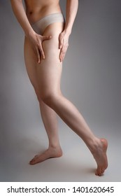 The woman shows a smooth and delicate skin on her legs. The concept of aesthetic medicine and skin imperfections.