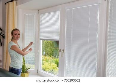 woman shuts down blinds