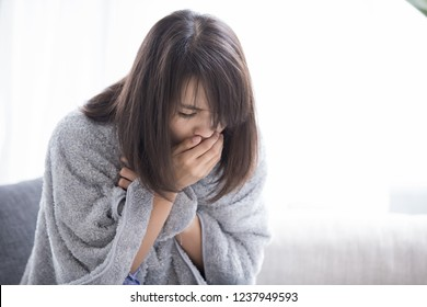 woman sick and cough with tissue paper at home