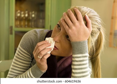 woman sick with handkerchief. symbol photo for colds, colds and flu season