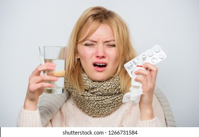 Woman sick person hold glass water and tablets blister. Take pills relieve fever. Drink plenty of fluids. Girl take medicine to break fever. Breaking fever concept. Headache and fever remedies.