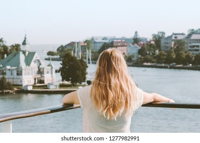 Woman sightseeing Helsinki city landmarks summer vacations in Finland traveling by ferry lifestyle blonde girl tourist relaxing alone