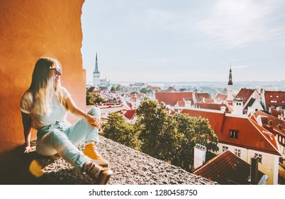 Woman sightseeing Tallinn city landmarks  vacations in Estonia travel lifestyle girl tourist relaxing at viewpoint Old Town aerial view architecture