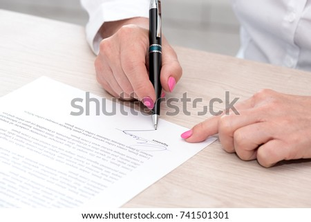 Woman Signing Legal Document Stock Photo Edit Now - Signing legal documents