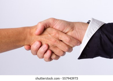 A woman signs a contract and uses her hand  Shaking man