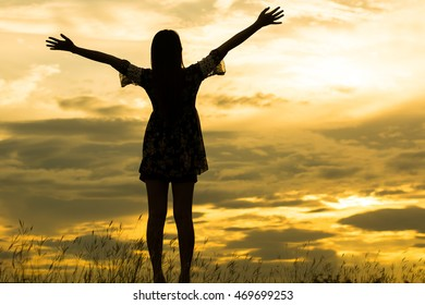 Woman silhouette standing on top of his outstretched arm to get fresh air