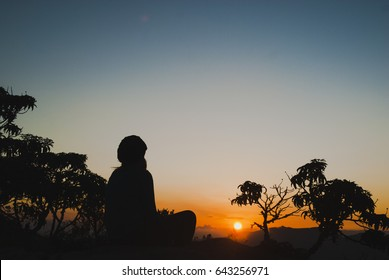Woman silhouette at sunrise in Brazil