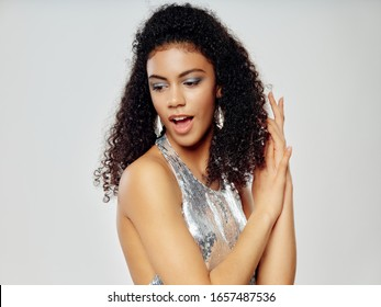Woman in a silver dress and curly hair model