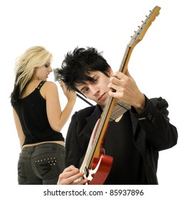 Woman singer and male guitarist close up in garage band isolated on white