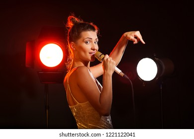 A woman sings a song in the studio