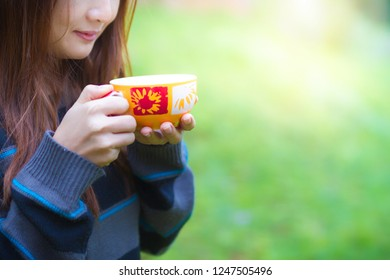 Woman sipping coffee in the garden