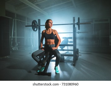 The woman sit in the fitness club