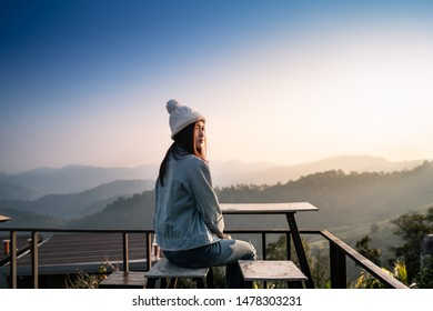woman sit and look forest with sunlight