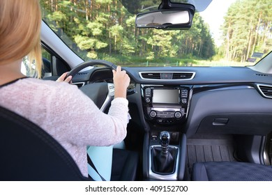 woman sit in modern  car in front of dashboard