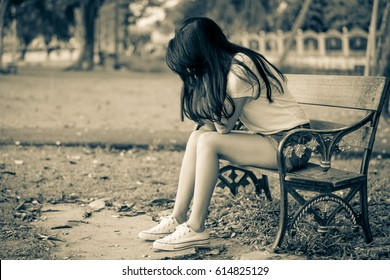 woman sit on the bench with dramatic tone