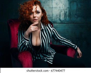 woman siting on red chair in nice interier