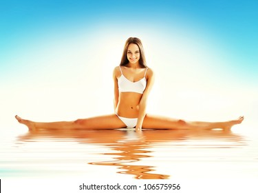woman siting on straddle split in water