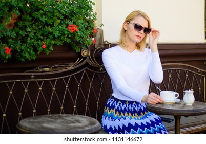 Woman sits alone cafe terrace urban background defocused. How enjoy being single tips. Woman lonely wait date. Dating advice for women. Still waiting him. Girl sit alone cafe waiting him.