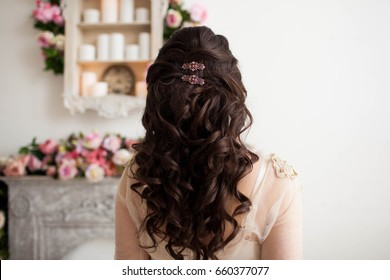 the woman sits back with a beautiful hair on white background