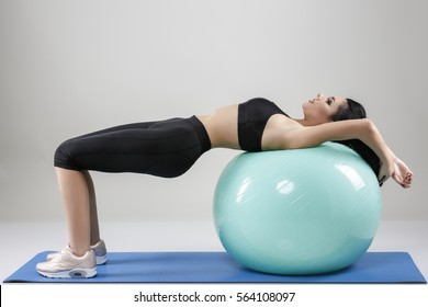 woman sits down and relaxes after exercise