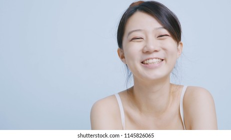 Woman sits at home and smile happily to you