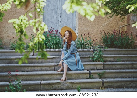 Woman Sits On Stairs Looks Into Stock Photo Edit Now 685212361